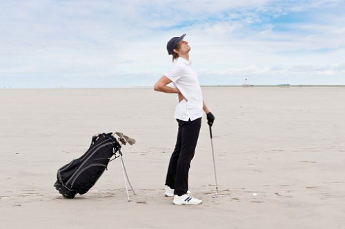 Should I play golf with a sore back?