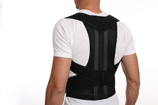 Should I wear a back brace at work if I have back pain
