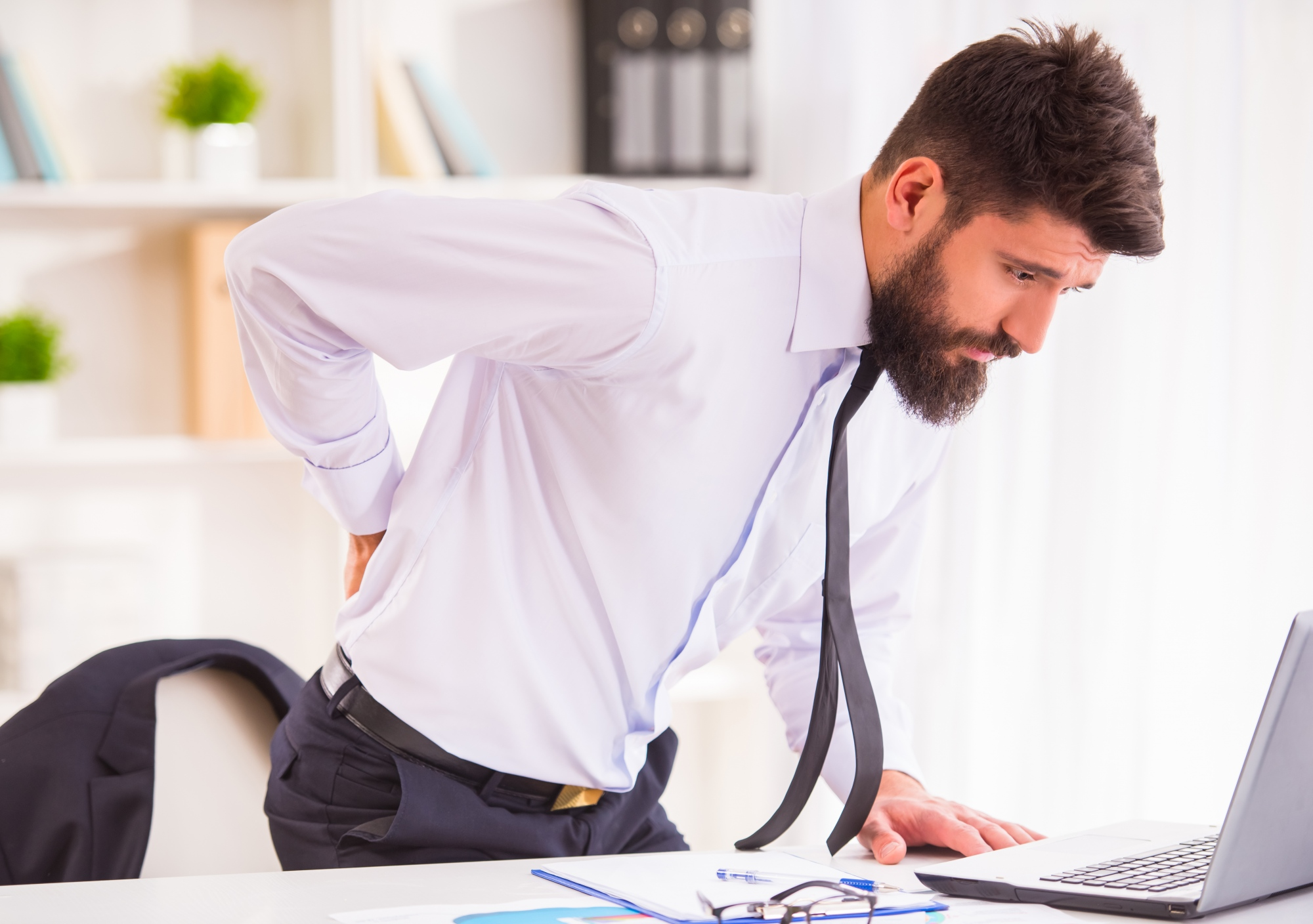 Why is lower back pain considered one of the hardest conditions to address?